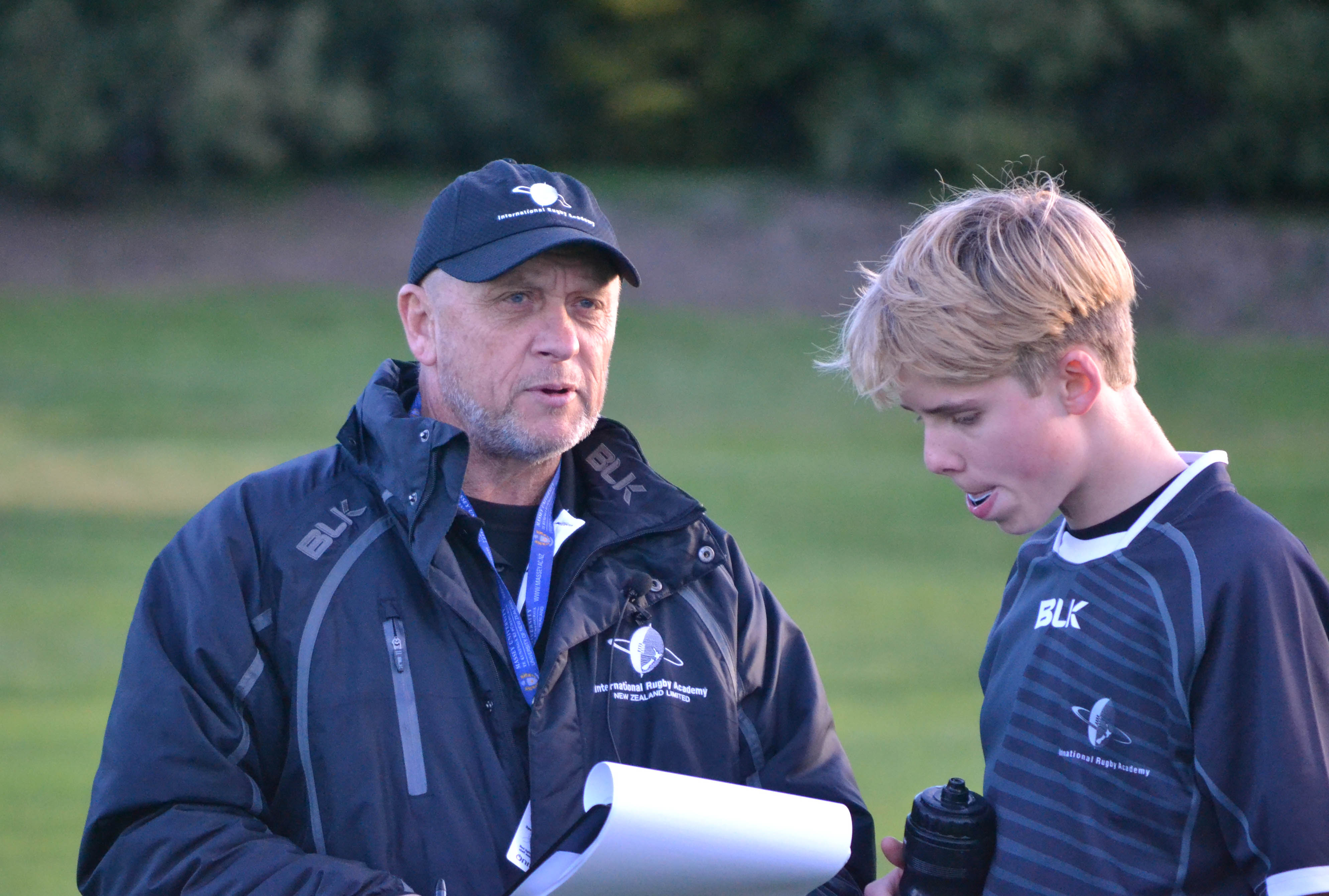 IRANZ Staff Coach Dave Ellis works with a halfback on the Intermediate Players Course